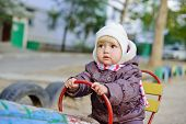 picture of scared baby  - a lovely baby girl on the playground - JPG