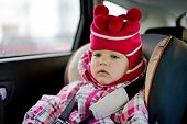 picture of car ride  - baby girl in car seat in the winter time - JPG