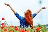pic of redhead  - redhead girl in field is enjoying sun - JPG