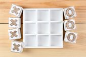 pic of tic  - Game of Tic Tac Toe on wooden background - JPG