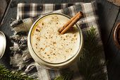 foto of cinnamon sticks  - Homemade White Holiday Eggnog with a Cinnamon Stick - JPG