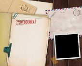stock photo of top-secret  - folder with TOP SECRET stamped across the front page and a blank photograph - JPG
