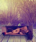 image of shoe-box  - a woman in a box over a river on a bridge toned with a retro vintage instagram filter effect - JPG