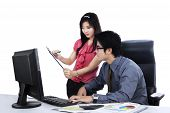 picture of secretary  - Secretary showing business report to her boss at office - JPG