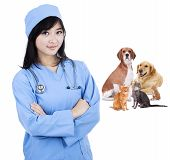 foto of vets surgery  - Female vet smiling with pet  - JPG