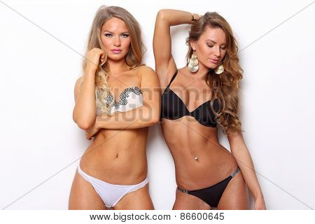 Two young woman posing in lingerie