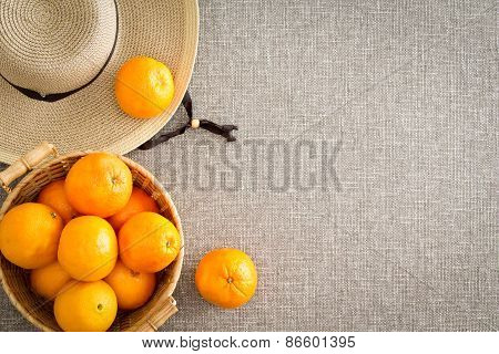 Harvest Of Farm Fresh Oranges With A Straw Sunhat