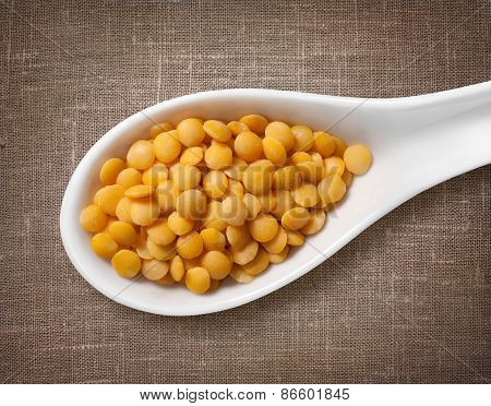 Yellow Lentil In White Porcelain Spoon / High-res Photo Of Grain In White Porcelain Spoon On Burlap