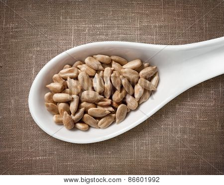 Peeled Sunflower Seeds In White Porcelain Spoon / High-res Photo Of Grain In White Porcelain Spoon O