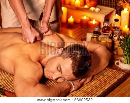 Man getting massage in spa. Female therapist.