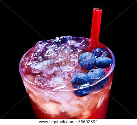 Cold red blueberry drink  with berry and straw. Top view. Close up.