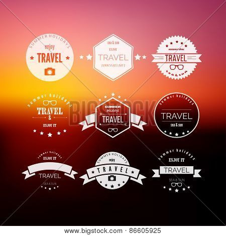 Set of travel signs on abstract  blurred background.