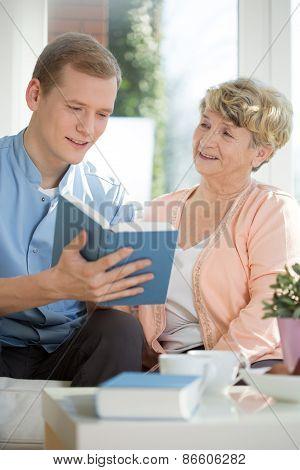 Male Caregiver Assisting Senior Woman