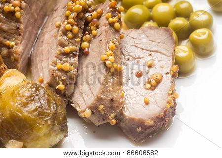Sliced Roast Beef With Brussels Sprouts And Peas