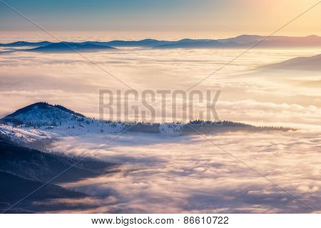 Mountain range glowing by warm sunlight at twilight. View from ski resort Dragobrat. Dramatic morning scene. Carpathian, Ukraine, Europe. Beauty world.
