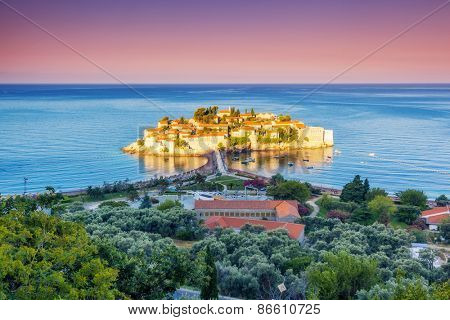 Fantastic view of the Sveti Stefan, small islet and resort in Montenegro. Dramatic morning light. Balkans, Adriatic sea, Europe. Beauty world.