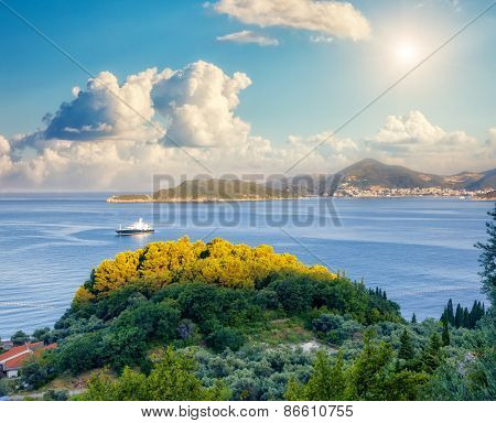 Fantastic view azure sea over Budva riviera in Montenegro. Dramatic morning scene. White fluffy clouds. Balkans, Adriatic sea, Europe. Beauty world.