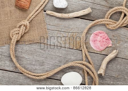 Ship rope with burlap on old wooden texture background with copy space