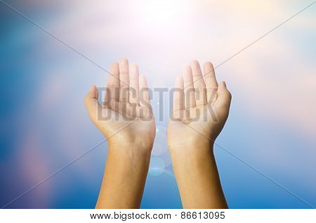 open two hands with abstract nature background