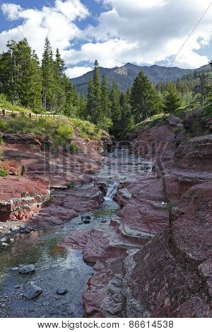 Mountain Stream Flowing Through Red Rock Canyon - Waterton Lakes National Park
