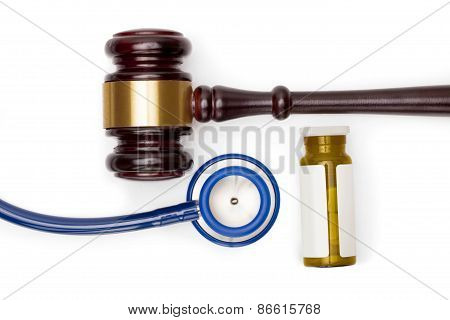 Judge Gavel, Pills Bottle And Stethoscope On White Backround