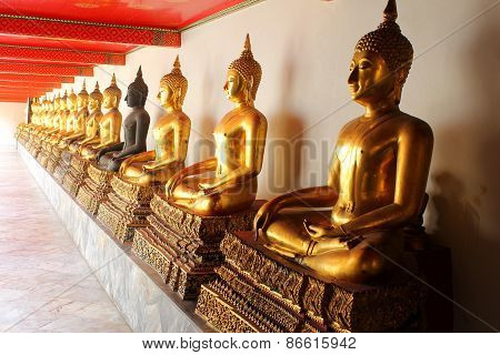 Shadow of The Meditation Buddha Statues In Buddhist Temple Wat Pho, Bangkok,