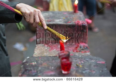 Burning joss sticks at Lunar New Year , Saigon, Vietnam
