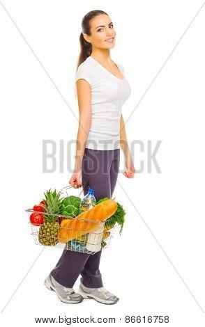 Young girl with food basket isolated