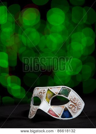 Carnival handmade mask with glittering background
