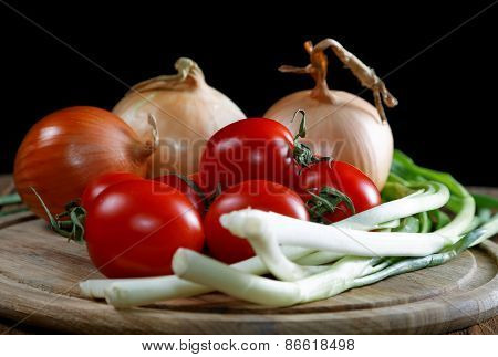 Onions Napiform Tomatoes On An Old Rural Table