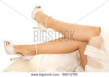 Woman Legs In Wedding Dress Lay