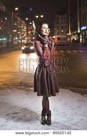 Fashion model look outside on a city street