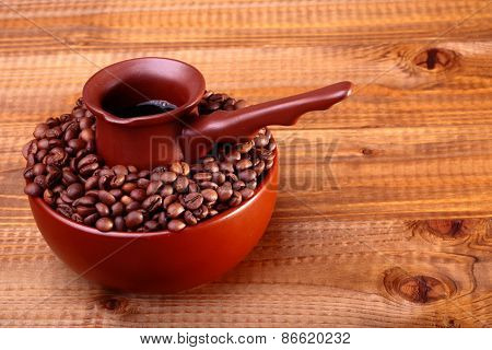 Coffee Beans In Bowl With Finjan