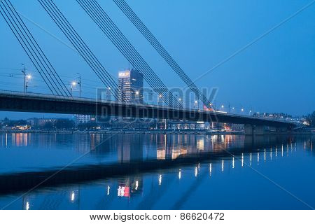 Night view of Riga bridge with reflection in Daugava