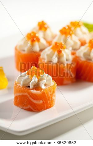 Maki Sushi - Philadelphia Roll made of Cream Cheese  inside. Fresh Raw Salmon outside