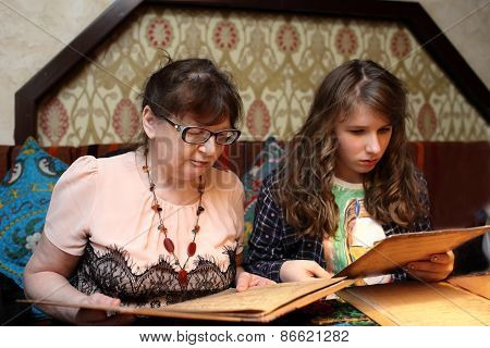 Grandma With Grandchild Looking Menu