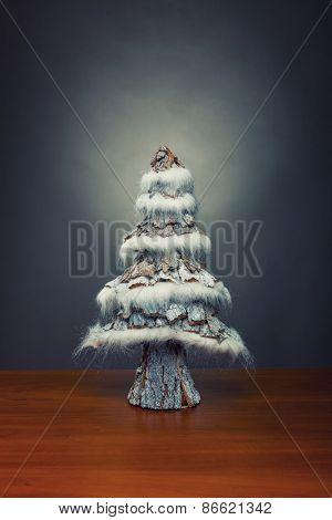 Small decorative christmas tree on wooden table