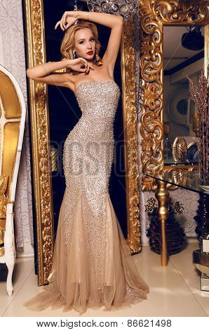 Blond Woman In Elegant Sequin Dress Posing In Luxurious Interior