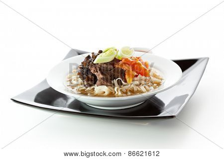 Soup with Chinese Noodles, Tomato, Beef, Onions and Mushrooms