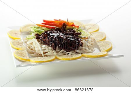 Udon with Cucumber, Sour Sweet Beef and Bell Pepper. Garnished with Lemon