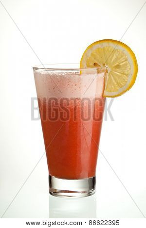 Cocktail with Raspberry and Orange Juice with Slice of Lemon