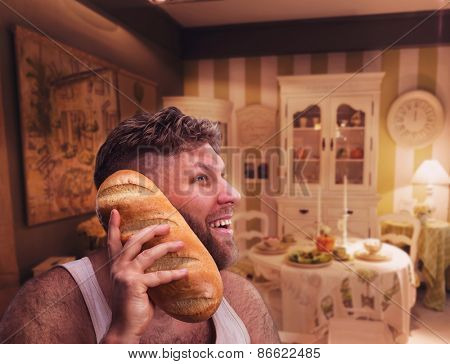 Strange happy man listening to something in bread in home interior