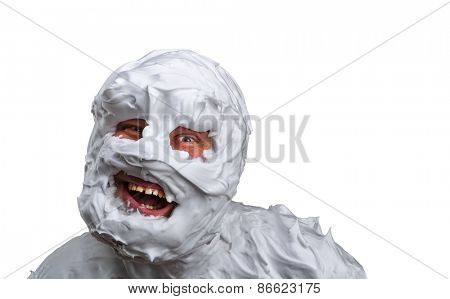 Spooky monster covered with foam isolated on white