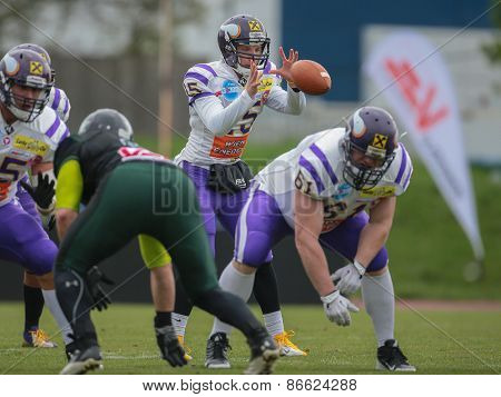 VIENNA, AUSTRIA - APRIL 13, 2014: QB Alexander Thury (#15 Vikings) catches the ball.