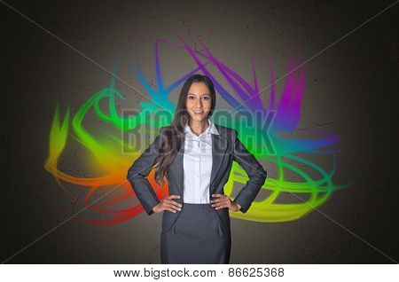 Young Female Business Executive in front Artistic Color Mixtures on Abstract Gray Gradient Background.