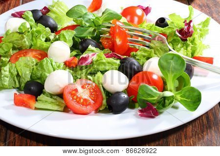Tomato Pinned On A Plug In Vegetable Salad