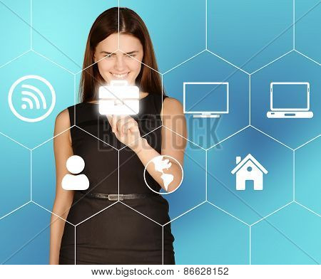 Business woman clicks on icon portfolio located in hexagon