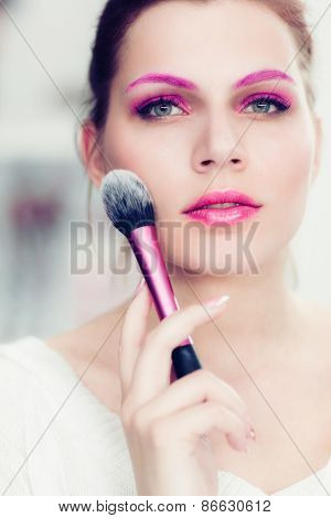The Makeup Artist Holds Rouge Brush