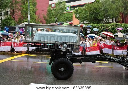 SINGAPORE MARCH 29:Gun carriage bearing the coffin of ex prime minister of Singapore, Mr Lee Kuan Yew driving pass the public paying their last respect on day of state funeral Mar 29 Singapore 2015
