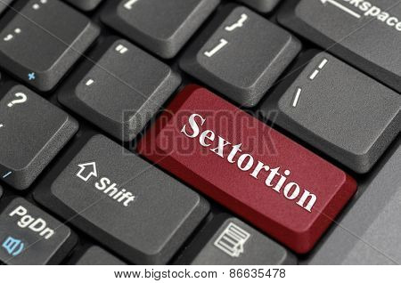 Red sextortion key on keyboard